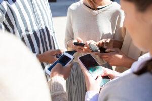 People texting via mobile phone